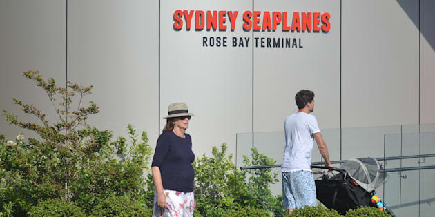 Visitors are seen at the entrance to the Sydney Seaplanes terminal in Rose Bay, Sydney on Jan. 1, 2018.