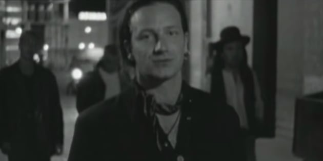 "U2 frontman Bono performs in the video for ""I Still Haven't Found What I'm Looking For."" Bono hailed the Canadian government's 2018 budget as ""leadership in action."""