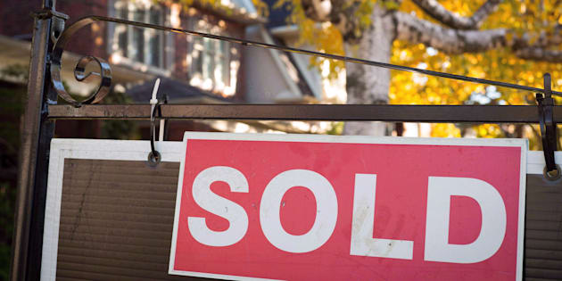 A real estate sold sign hangs in front of a west-end Toronto property Nov. 4, 2016.