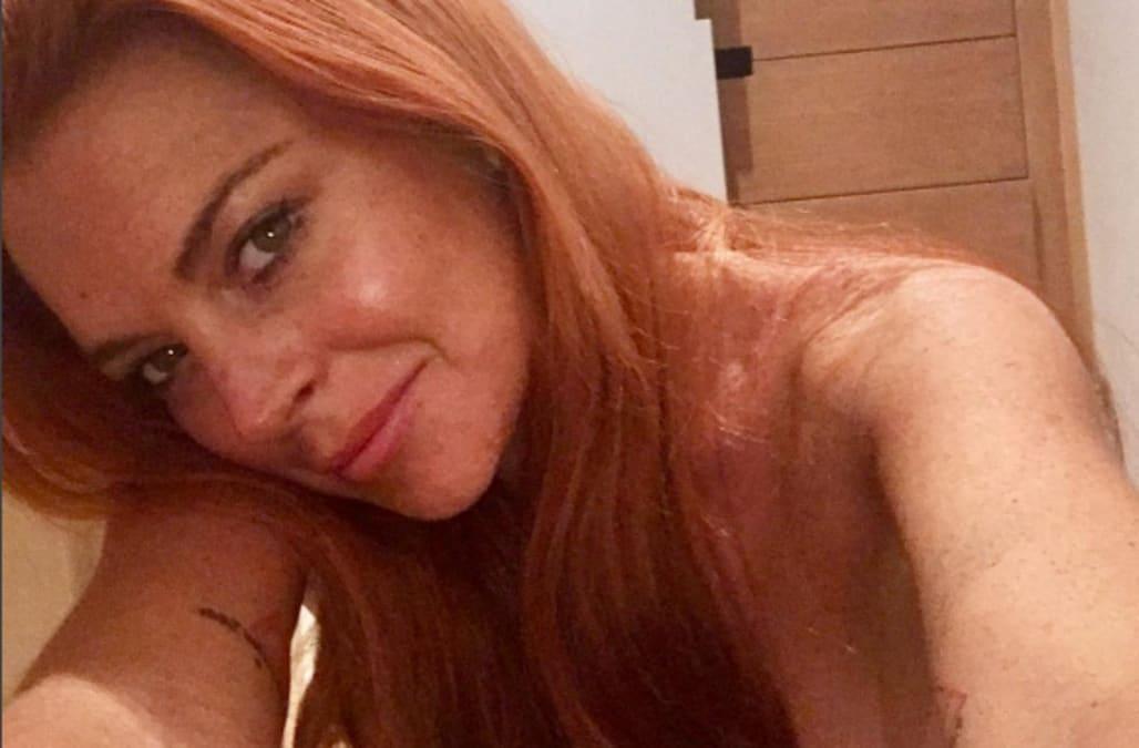 Lindsay Lohan posts topless photo of 'upper half' on Instagram