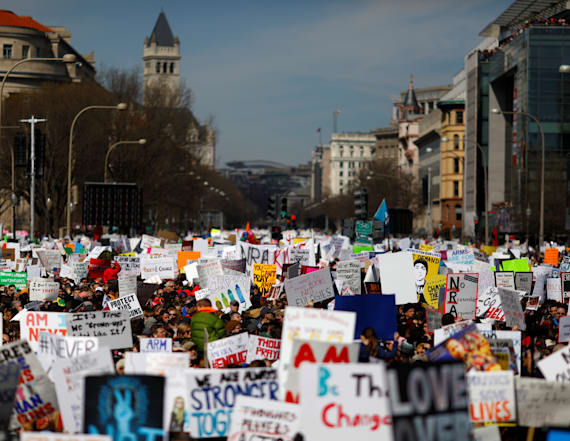 Massive crowds rally to urge tighter gun control