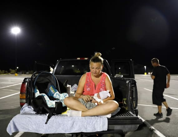 Baby born after storm starts life in parking lot