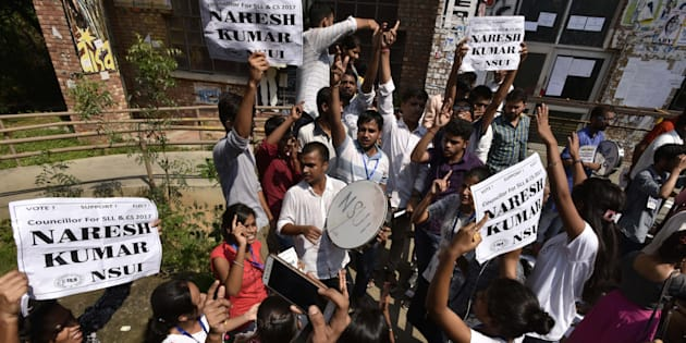 NSUI supporters shout slogans during JNU Student Union election Voting Day at the Campus.