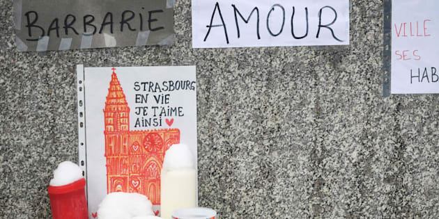 A drawing depicting the Strasbourg Cathedral reading 'Strasbourg alive, this is how I love you' is pictured during a gathering around a makeshift memorial at Place Kleber, in Strasbourg, on December 16, 2018 to pay a tribute to the victims of Strasbourg's attack. - Four people were killed and 12 wounded when a lone gunman, identified as Cherif Chekatt, 29, opened fire on shoppers near the Christmas market, on December 11, 2018, according to French officials. (Photo by SEBASTIEN BOZON / AFP)        (Photo credit should read SEBASTIEN BOZON/AFP/Getty Images)