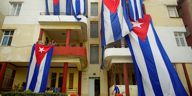Cuban flags are seen hung up to dry after Hurricane Irma caused flooding and a blackout, in Havana, Cuba September 11, 2017. REUTERS/Alexandre Meneghini