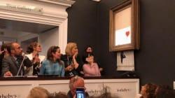 Si aggiudica l'opera di Banksy per un milione di sterline, ma subito dopo il quadro si autodistrugge e lascia tutti di