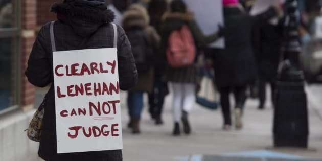 A demonstrator marches through downtown Halifax in protest of Judge Gregory Lenehan's decision to acquit a taxi driver charged with sexual assault during a rally in Halifax on March 7, 2017.