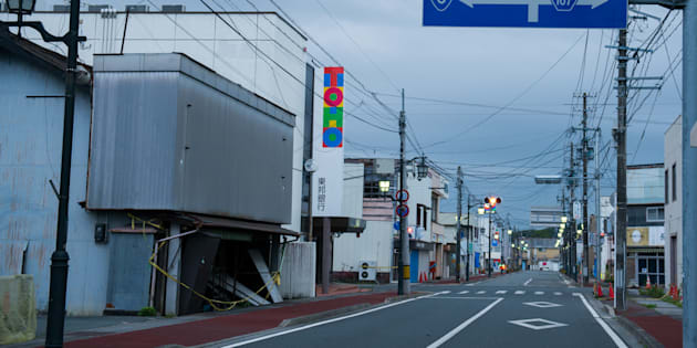 """The town of Namie was home to almost 20,000 people, but its bustling port was wiped out by the tsunami; the rest of the town bears scars from the earthquake, and years of municipal neglect."""