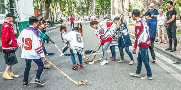 Ron Reeleder oversees a game of ball hockey in Vietnam.