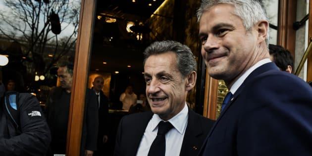 (Photo d'illustration: Nicolas Sarkozy et Laurent Wauquiez, le 8 décembre 2017, à Lyon)