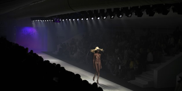 Model Mala Bryan walks during a show with the South African designer Gavin Rajah during the Mercedes-Benz Joburg Fashion Week on March 6, 2015 in Melrose Arch.
