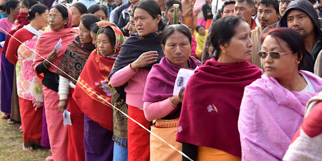 Voters queue at a polling station in Thoubal on 8 March 2017 in Manipur.