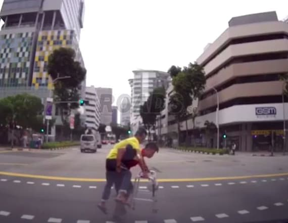 DHL driver carries man across street in viral video