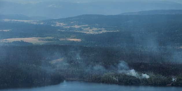 Wildfires are seen from a Canadian Forces Chinook helicopter as Prime Minister Justin Trudeau views areas affected by wildfire near Williams Lake, B.C., on Monday, July 31, 2017.