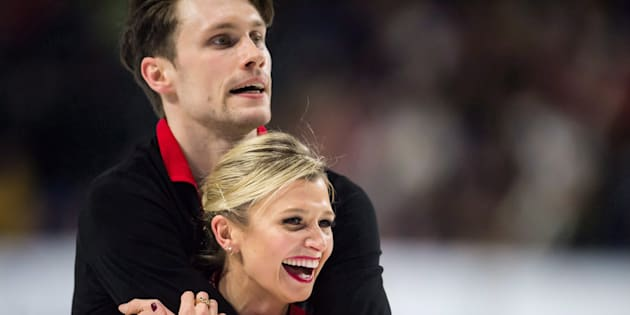 Kirsten Moore-Towers, front, and Michael Marinaro react after performing their short program during the senior pairs competition at the Canadian Figure Skating Championships in Vancouver, B.C., on Jan. 12, 2018.