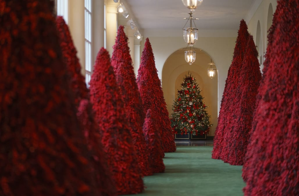 Christmas Topiary Decor.Melania Trump S Red Topiary Trees A Hit At Christmas Parties