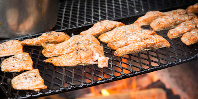 Fresh coho salmon cooking on an outdoor grill, Juneau, Alaska, USA