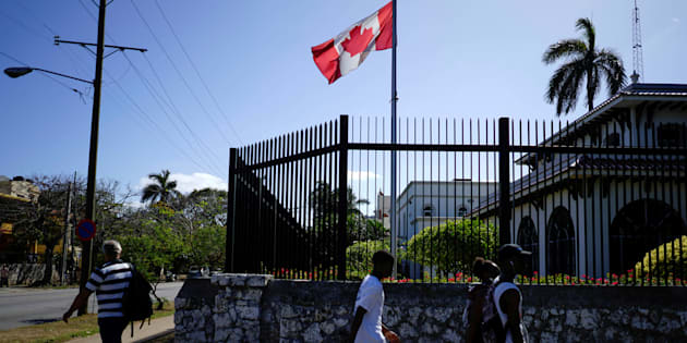People pass by the Canada's Embassy in Havana, April 16, 2018.