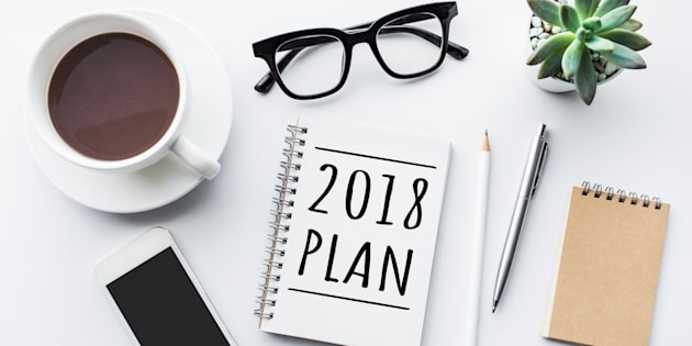 2018 plan text on notepad with office accessories.Business motivation,inspiration concepts