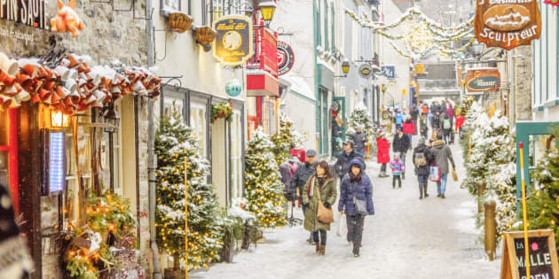 winter day in the petit champlain neighborhood in quebec city - Best Christmas Getaways