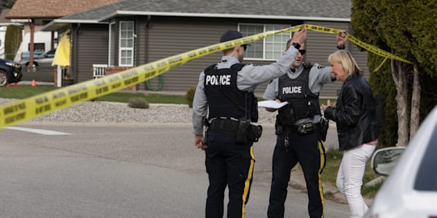 RCMP officers work outside a crime scene in Penticton, B.C., on April 15, 2019.