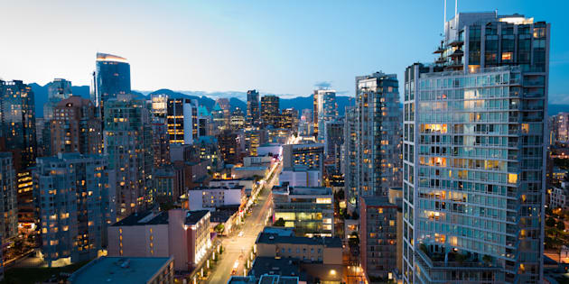 Downtown Vancouver at dusk. The city has the lowest property tax rate of any major municipality in North America, according to calculations from Zoocasa and Bloomberg.