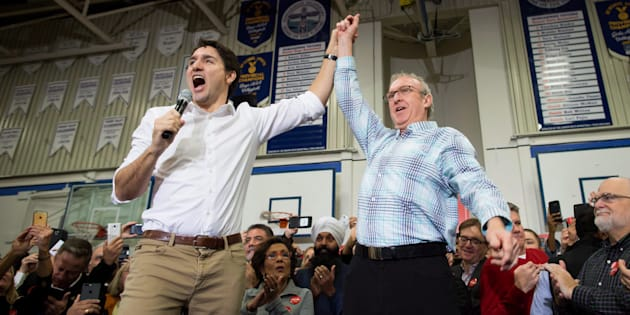 Prime Minister Justin Trudeau, left, and South Surrey-White Rock Liberal byelection candidate Gordie Hogg attend a rally in Surrey, B.C., on Dec. 2, 2017.