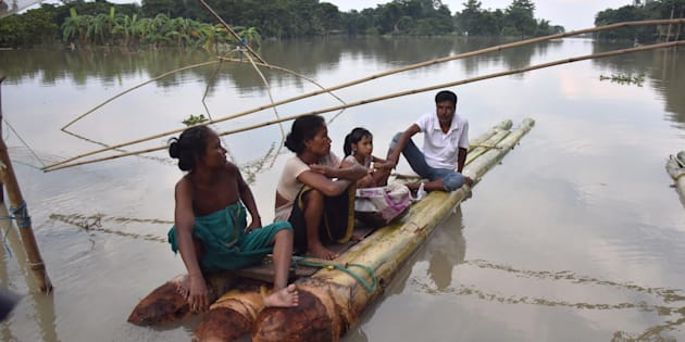Indian villagers take rest on a raft in the flood-affected Bordiya Kacharigoan village in Assam.