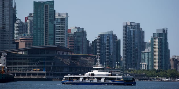Condo towers rise behind a Seabus commuter vessel in Vancouver's harbour, Tuesday, July 11, 2017. The Real Estate Board of Greater Vancouver says market conditions in the city are changing as sales in April fell to a 17-year low for the month.