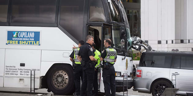 Darryl Dyck  Canadian Press                       Police officers stand nearby after a collision involving a tour bus and pedestrians in Vancouver on Sunday