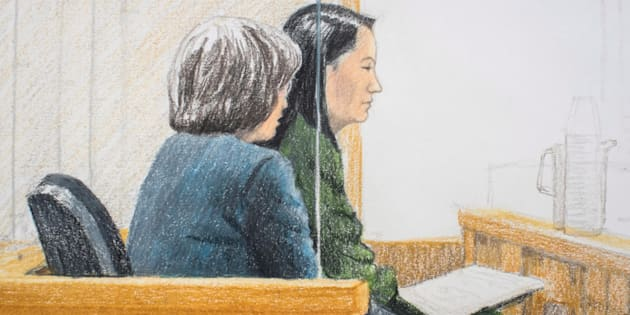 In this courtroom sketch, Meng Wanzhou (right), the chief financial officer of Huawei Technologies, sits beside a translator during a bail hearing at B.C. Supreme Court in Vancouver, Fri. Dec. 7.