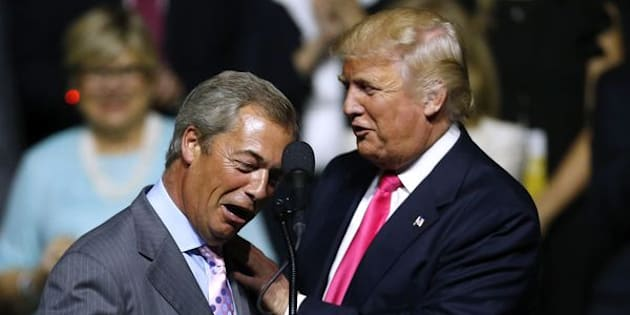 JACKSON, MS - AUGUST 24: Republican Presidential nominee Donald Trump, right, greets United Kingdom Independence Party leader Nigel Farage during a campaign rally at the Mississippi Coliseum on August 24, 2016 in Jackson, Mississippi. Thousands attended to listen to Trump's address in the traditionally conservative state of Mississippi. (Photo by Jonathan Bachman/Getty Images)