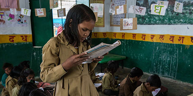 Sakhi, 8, reads to her classmates. According to her teacher, her reading and writing has improved since she began participating in the Literacy Boost programme.