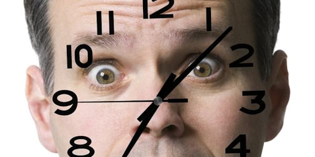 Portrait of a mid adult man with a clock super imposed on his face