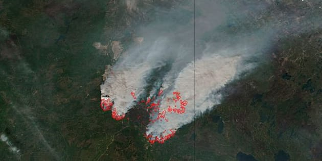 NASA's satellite image shows columns of smoke rising up from the myriad of wildfires, with NASA outlining actively burning areas in red over the Fort McMurray, Alberta, Canada on May 16, 2016