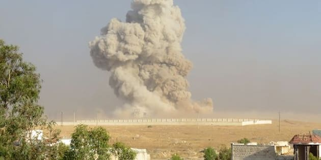 Smoke rises after anti-regimist opposition forces hit Assad regime forces' base in Aleppo.