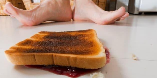 Toast with jam lying backwards on floor