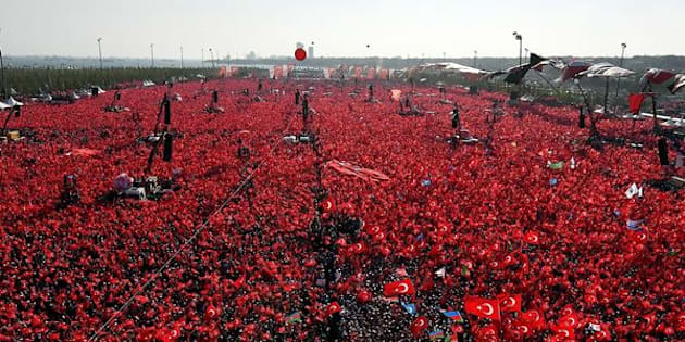 People hold Turkish flags as they take part in Democracy and Martyrs' Rally, held to protest against the July 15 failed coup, in Istanbul.
