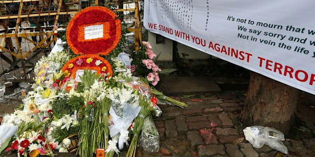 Wreaths and flowers, offered by people to pay tribute to the victims of the attack on the Holey Artisan Bakery and the O'Kitchen Restaurant, are pictured at a makeshift memorial near the attack site, in Dhaka, Bangladesh, July 5, 2016. REUTERS/Adnan Abidi