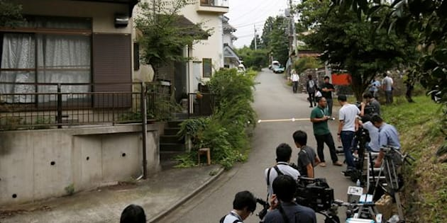 Media members gather in front of the home of a man who went on a deadly attack at a facility for the disabled, near the facility in Sagamihara, Kanagawa prefecture, Japan.