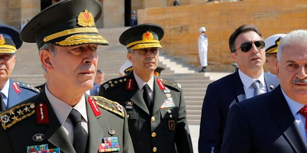 Turkey's Prime Minister Binali Yildirim (R), flanked by Chief of Staff General Hulusi Akar (L) and the country's top generals, leaves Anitkabir the mausoleum of modern Turkey founder Mustafa Kemal Ataturk in Ankara on Thursday.
