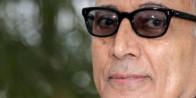 """Director Abbas Kiarostami poses during a photocall for the film """"Like Someone in Love"""" in competition at the 65th Cannes Film Festival, May 21, 2012.                          REUTERS/Eric Gaillard (FRANCE  - Tags: ENTERTAINMENT)"""