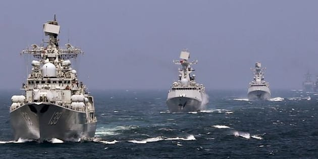 Chinese and Russian naval vessels participate in the Joint Sea-2014 naval drill outside Shanghai on the East China Sea, May 24, 2014. Chinese and Russian navies staged exercises on the East China Sea on Saturday to simulate anti-submarine and search-and-rescue operations. A total of 14 surface ships, two submarines, nine fixed-wing warplanes, six shipboard helicopters and two operational detachments are taking part in this year's week-long drill, state media reported. Picture taken May 24, 2014. REUTERS/China Daily (CHINA - Tags: POLITICS MILITARY) CHINA OUT. NO COMMERCIAL OR EDITORIAL SALES IN CHINA