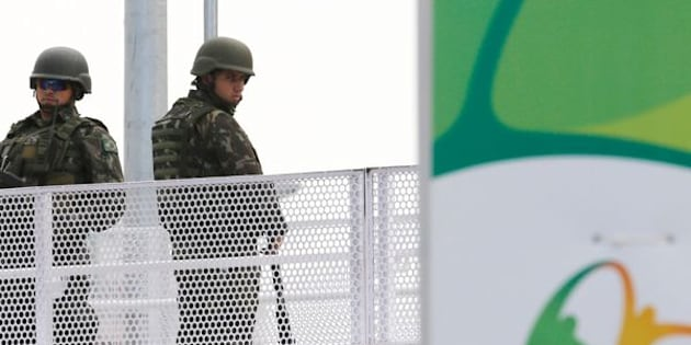Soldiers stand at a station on Metro Line 4.
