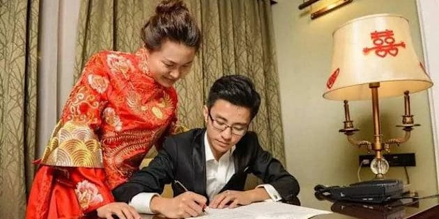 "Hand copying the Chinese constitution left newlyweds Li Yunpeng and Chen Xuanchi ""with fond memories on their wedding night,"" their employer said."