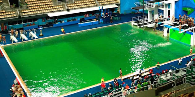 This photo of the Olympicdiving pool on Tuesdayshows the water at the peak of its green swing.