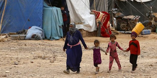 Rebels and a senior Western diplomat said Russian jets hit the Hadalat area near Syria's border with Jordan where hundreds of refugees are sheltering, pictured above in May.