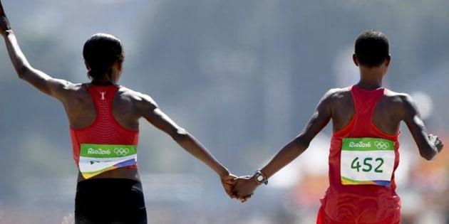 Kenya's Jemima Sumgong and Bahrain'sEunice Jepkirui Kirwacelebrate taking gold and silver in the women's marathon at Rio 2016 on Sunday.