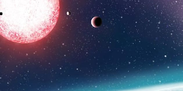 Artist's rendering of Kepler-186f, one of more than 200 exoplanets that researchers say lie within the habitable zone of their host stars and could potentially harbor life.