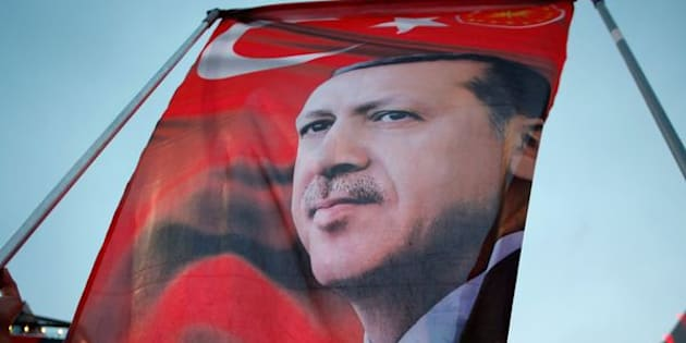 A supporter holds a flag depicting Turkish President Tayyip Erdogan during a pro-government demonstration in Ankara, Turkey, July 20, 2016. REUTERS/Baz Ratner